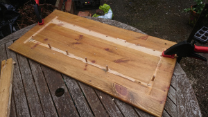 reclaimed wood with dowels sticking out and glue in patches